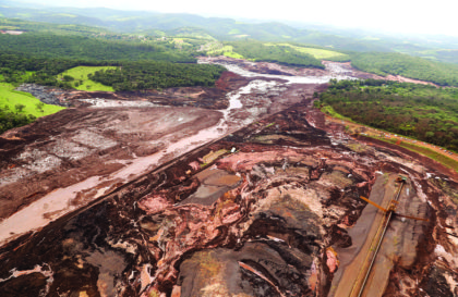 An aerial view shows the area of a collapsed dam in Brumadinho, Brazil, Saturday, Jan. 26, 2019. Rescuers searched for survivors in a huge area in southeastern Brazil buried by mud from the collapse of dam holding back mine waste, with several people dead and hundreds missing.  (AP Photo/Andre Penner)