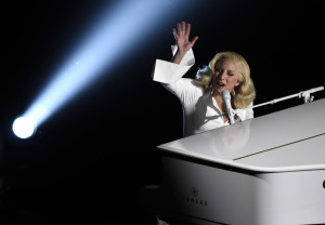"""Lady Gaga performs """"Til It Happens To You"""" that is nominated for best original song from """"The Hunting Ground"""" at the Oscars on Sunday, Feb. 28, 2016, at the Dolby Theatre in Los Angeles. (Photo by Chris Pizzello/Invision/AP)"""