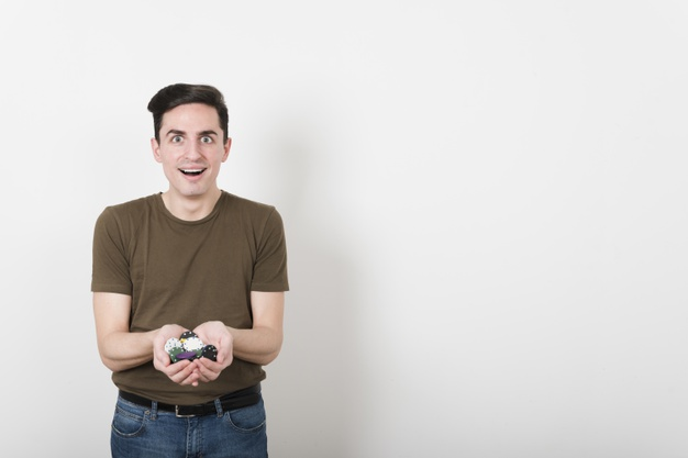 front-view-happy-man-with-poker-chips_23-2148234856